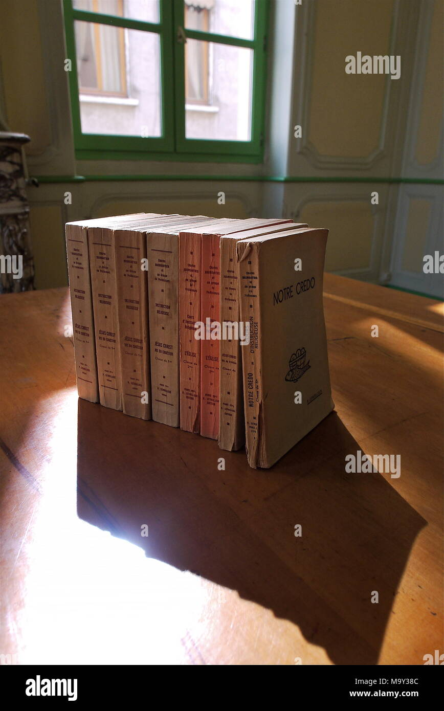 Religious books displayed on a table in a religious college of Lyon, France - Stock Image