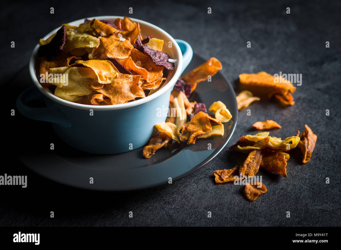 Mixed fried vegetable chips in pot. - Stock Image