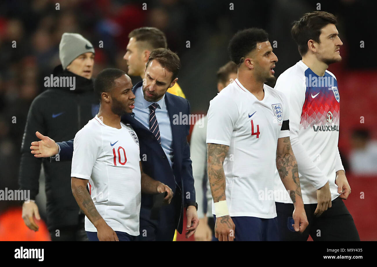 England's Raheem Sterling is consoled by England manager Gareth Southgate after the final whistle - Stock Image