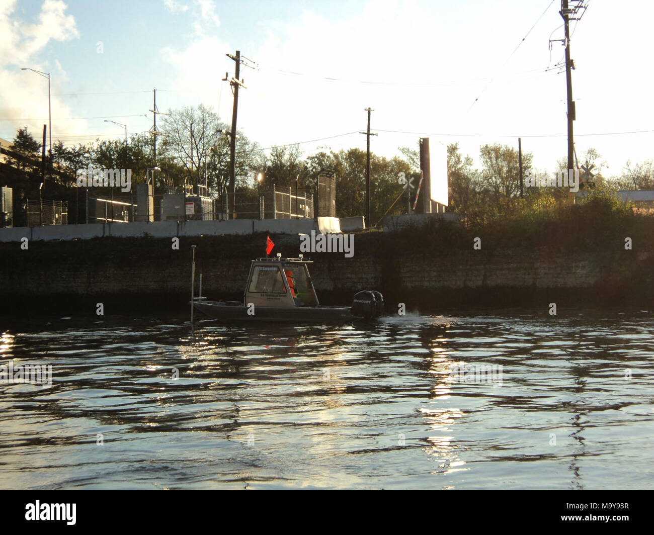 Electric Barrier Fish Clearing. USGS boat taking water velocity measurements. Photo - Stock Image