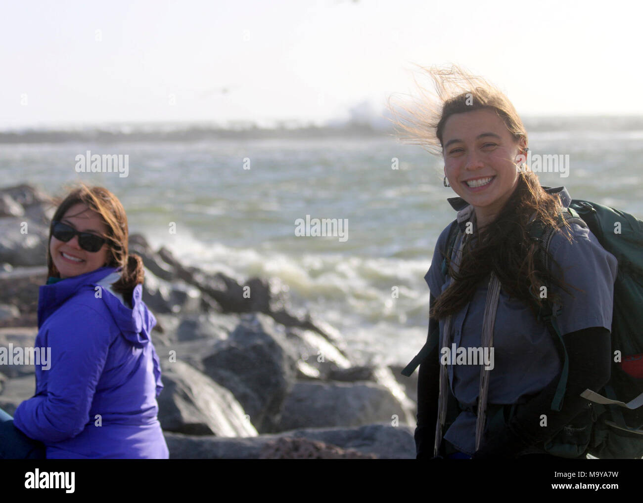 Kendra Chan (left) and Karen Sinclair, fish and wildlife biologists. OXNARD, Calif. (May 6, 2017) Kendra Chan (left) and Karen Sinclair, fish and wildlife biologists with the U.S. Fish and Wildlife Service in Ventura, during the biannual brown pelican survey along the West Coast. The survey is conducted with the intent to gather information needed to understand how potential threats from changes in weather patterns, prey availability, or changes in habitat or contaminants could impact California brown pelican populations over time. Stock Photo