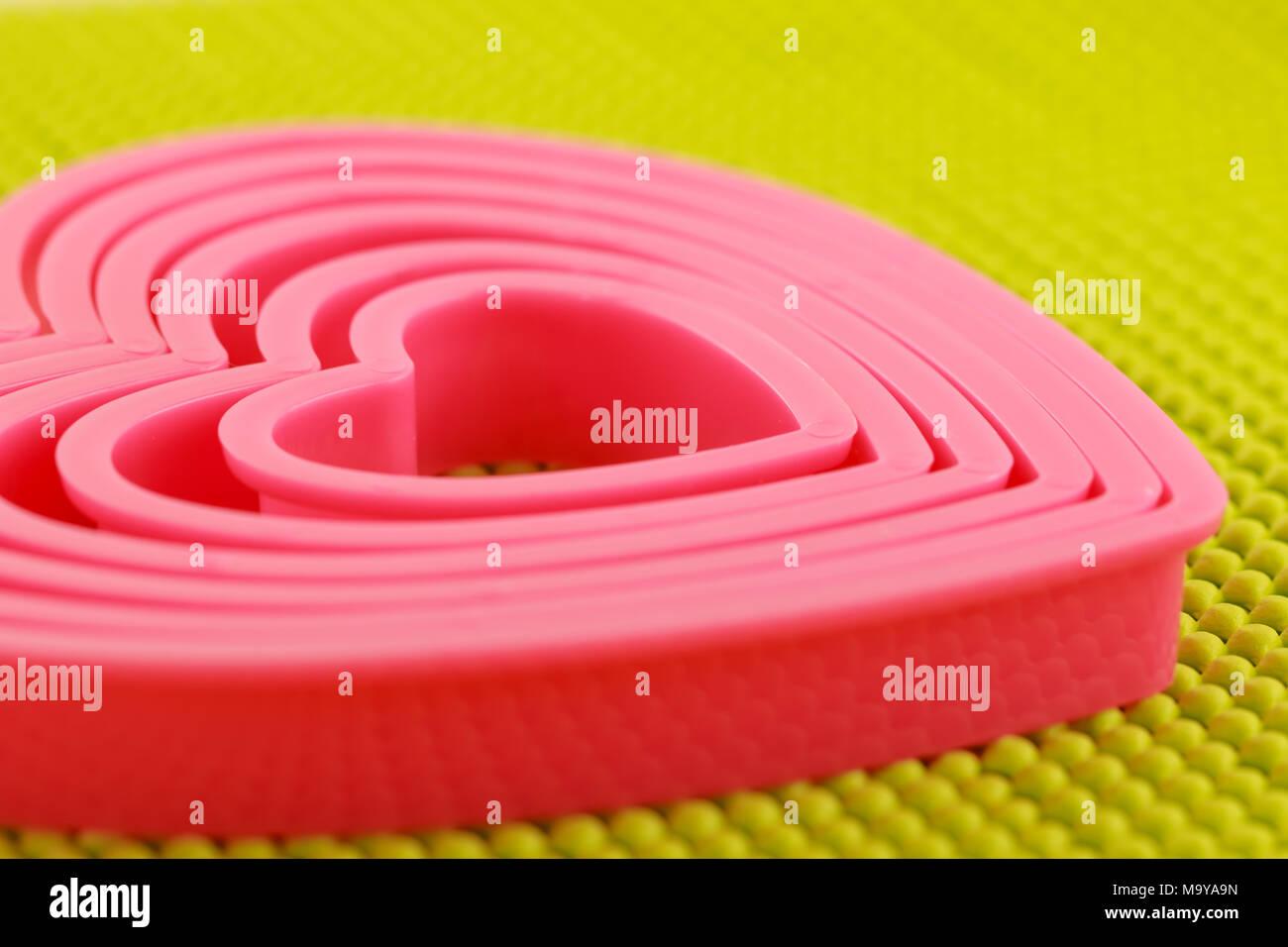 Pink plastic heart on  non skid mat Stock Photo
