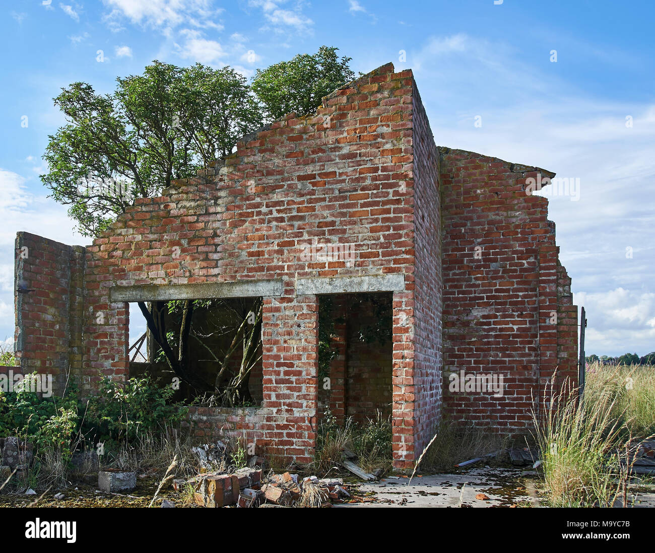 One of the many old Brick built Building ruins that can be found around the site of RAF Kinnell near Arbroath, Scotland. - Stock Image
