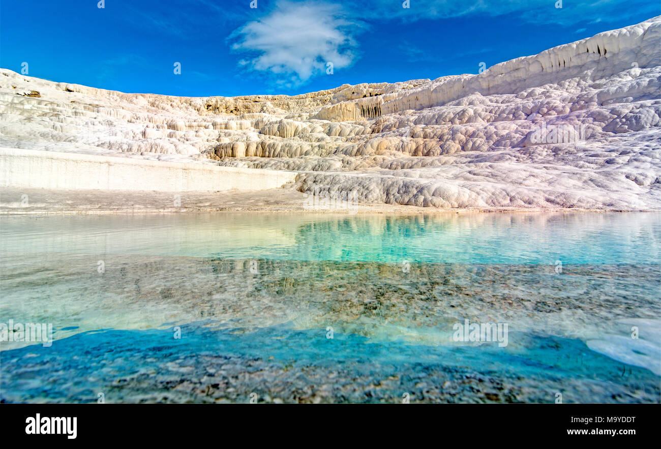 pamukkale travertine,Traverten is a versatile, slip formed by chemical reaction post-precipitation due to various causes and environments. Geological - Stock Image