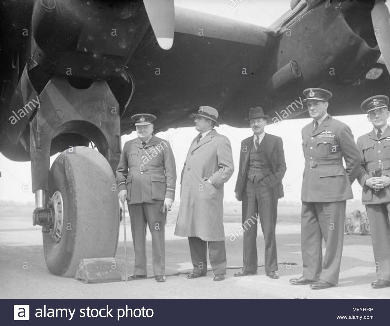Royal Air Force 1939-1945- Bomber Command Winston Churchill, in the uniform of an Air Commodore, with Dr H V Evatt (Australian Minister for External Affairs), Clement Attlee (Deputy Prime Minister) and Air Vice-Marshal C R Carr (AOC No 4 Group) during a visit to a Yorkshire-based Halifax squadron on 15 May 1942. - Stock Image