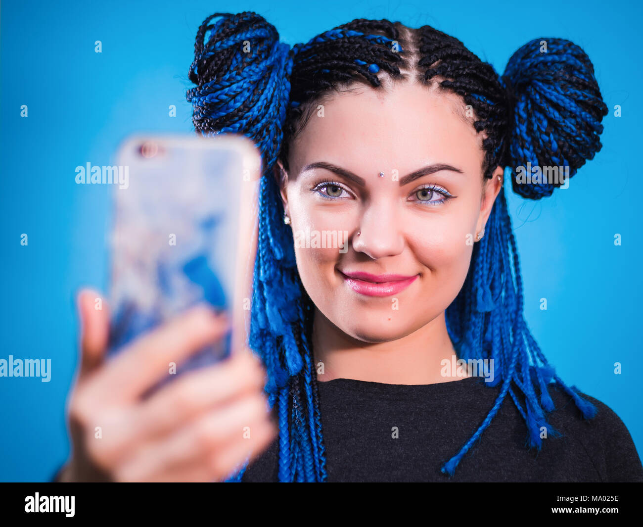 adorable hipster caucasian female with african colorful braids