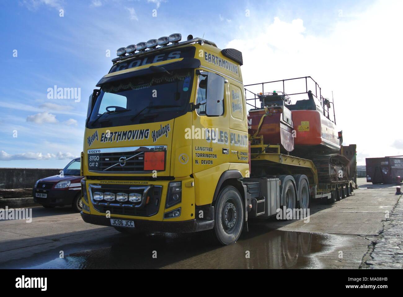 Volvo FH16 with low loader trailer and excavator on Haldon Pier, Torquay, Devon, England, UK Stock Photo