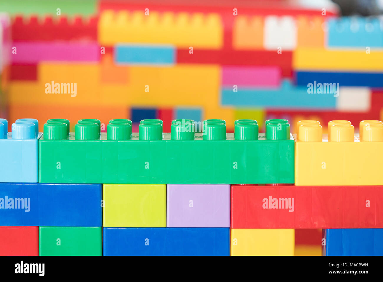 Colorful stacked toy plastic building blocks Stock Photo: 178259585