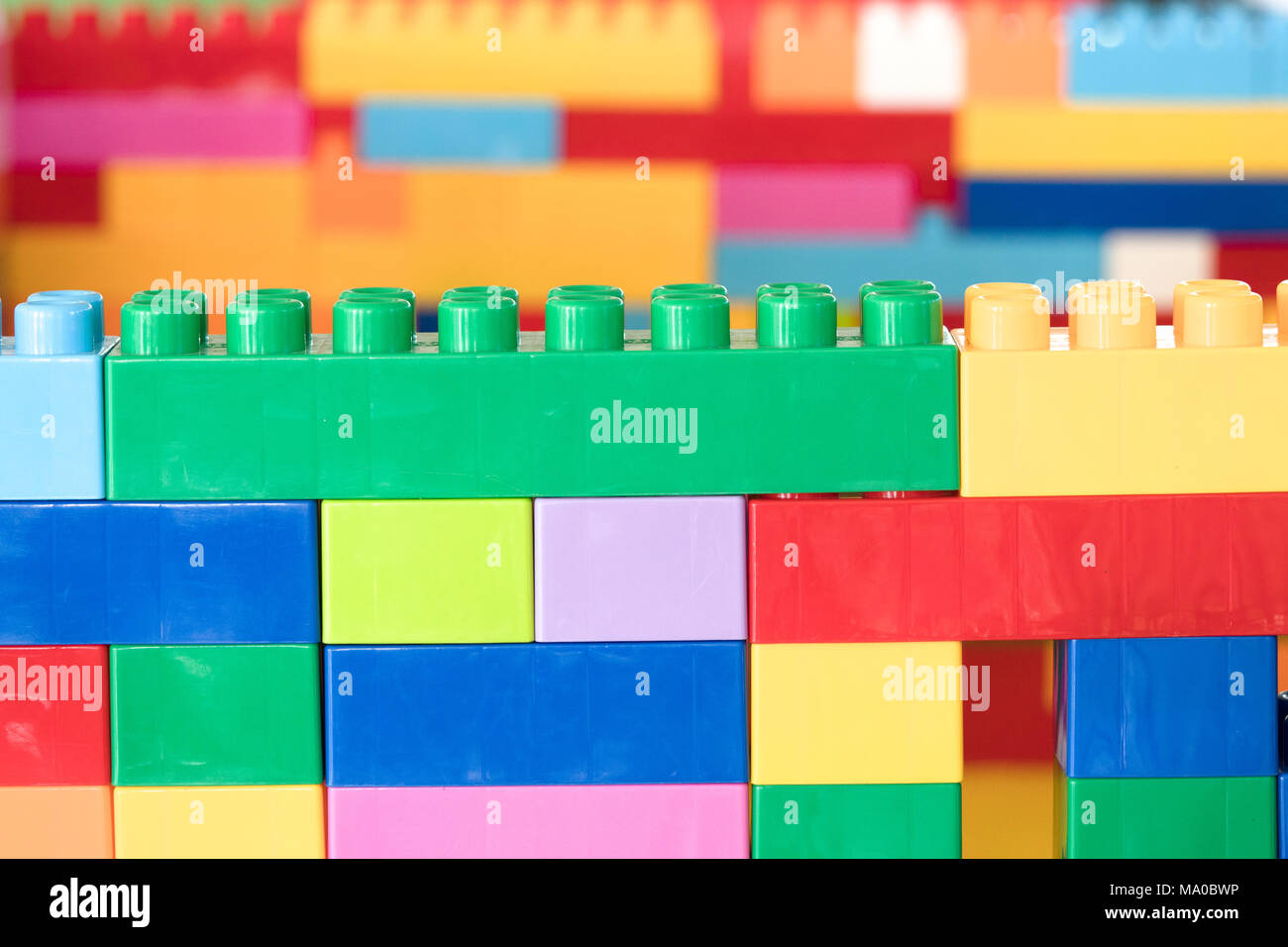 Colorful stacked toy plastic building blocks Stock Photo: 178259586