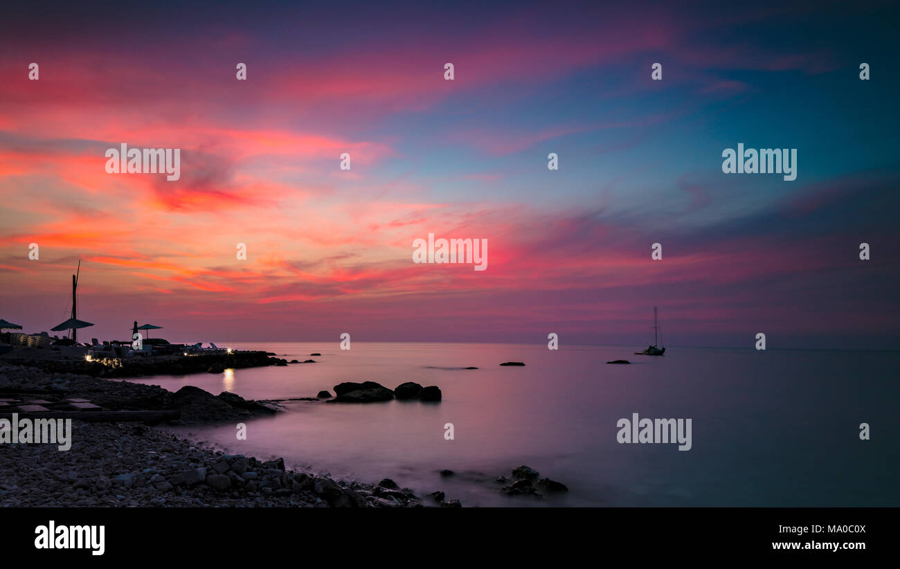 Beautiful Pink Sunset Landscape Amazing View On The Colorful Dramatic Sky Over Stony Beach Peaceful Place For Summer Vacation Romantic Resort