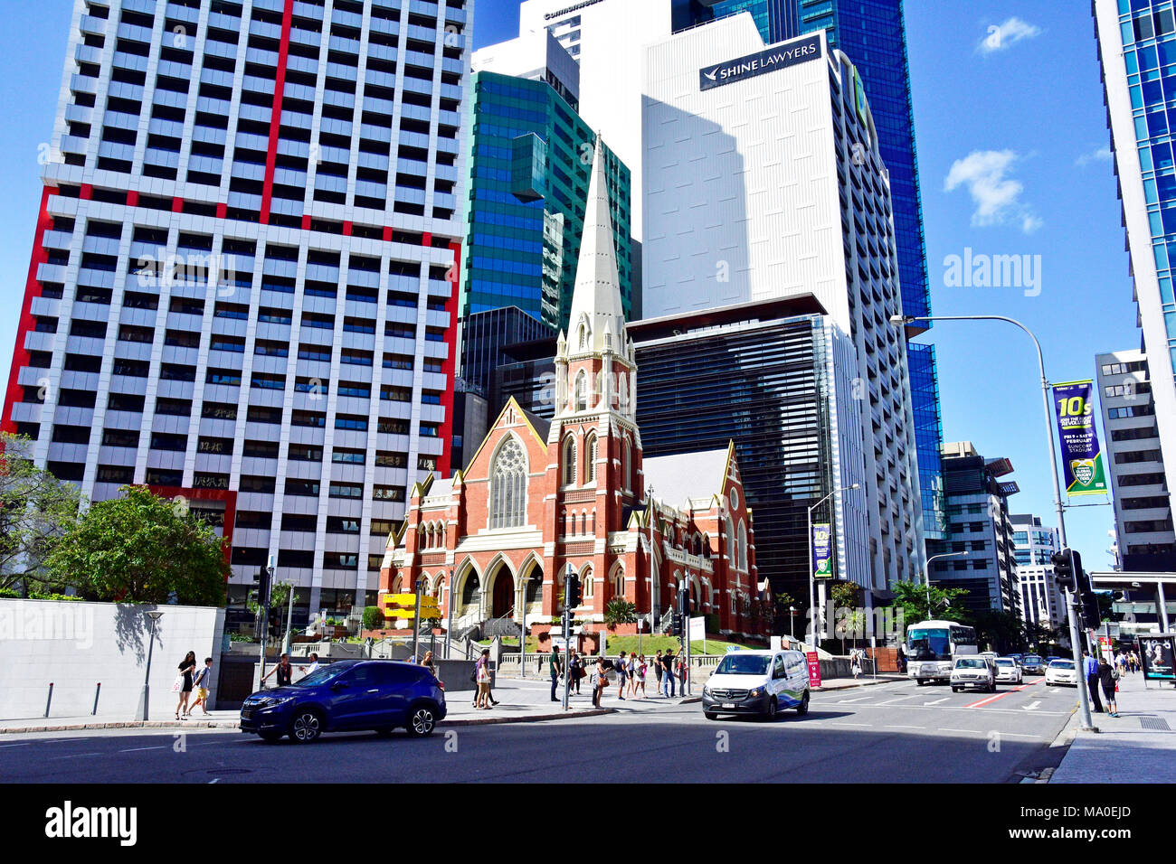 CHURCH SURROUNDED BY HIGH RISE BUILDINGS IN BRISBANE CITY AUSTRALIA - Stock Image
