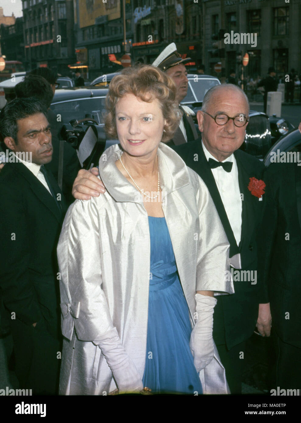 ANNA NEAGLE (1904-1986) English film actress with husband Herbert Wilcox at a London premiere about 1965 - Stock Image
