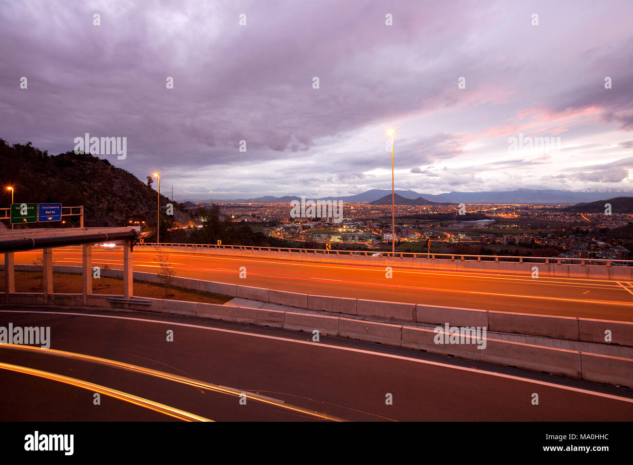 Freeway and panoramic view of western side of the city, Vitacura, Santiago, Chile - Stock Image