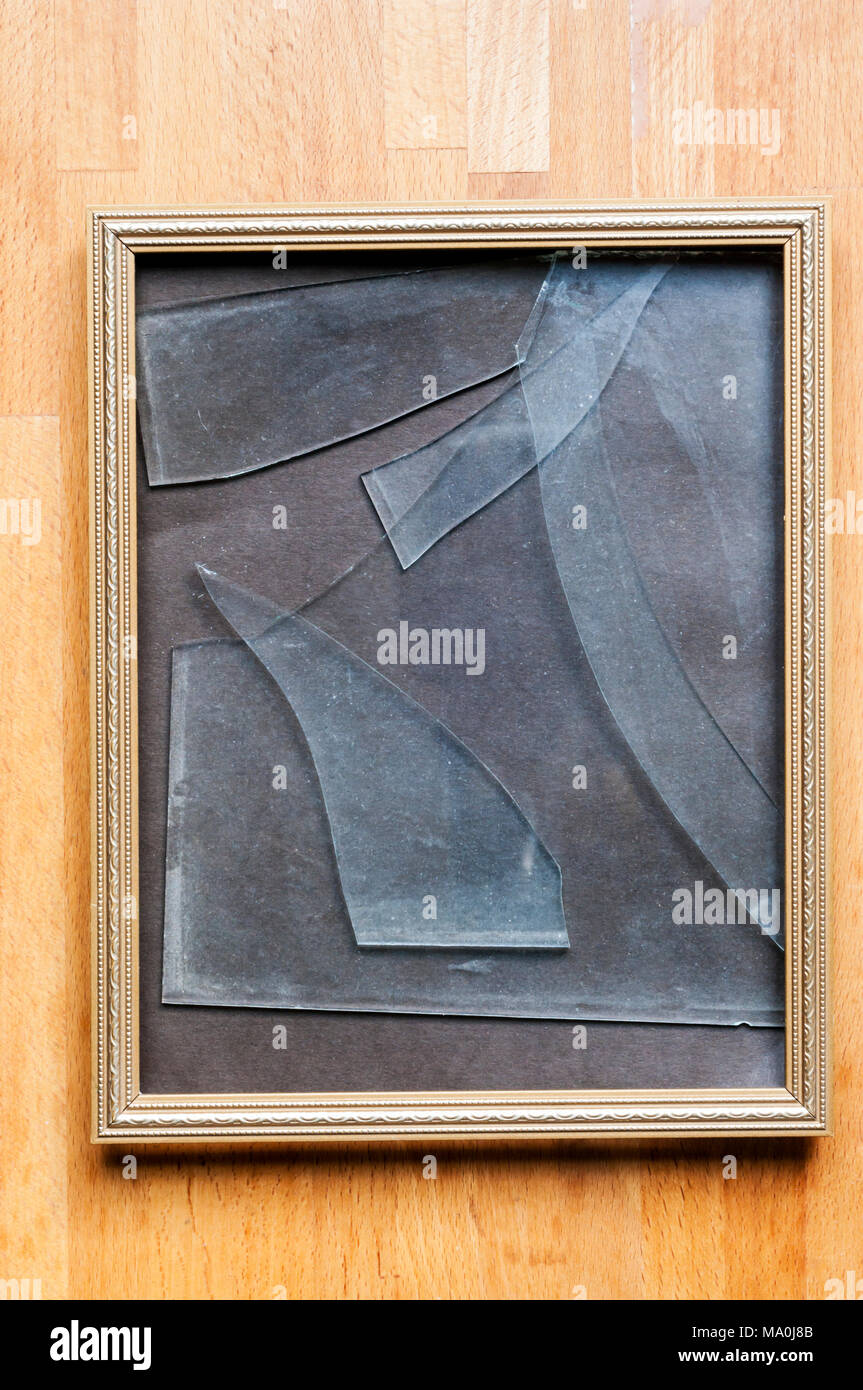 Broken glass in picture frame. - Stock Image