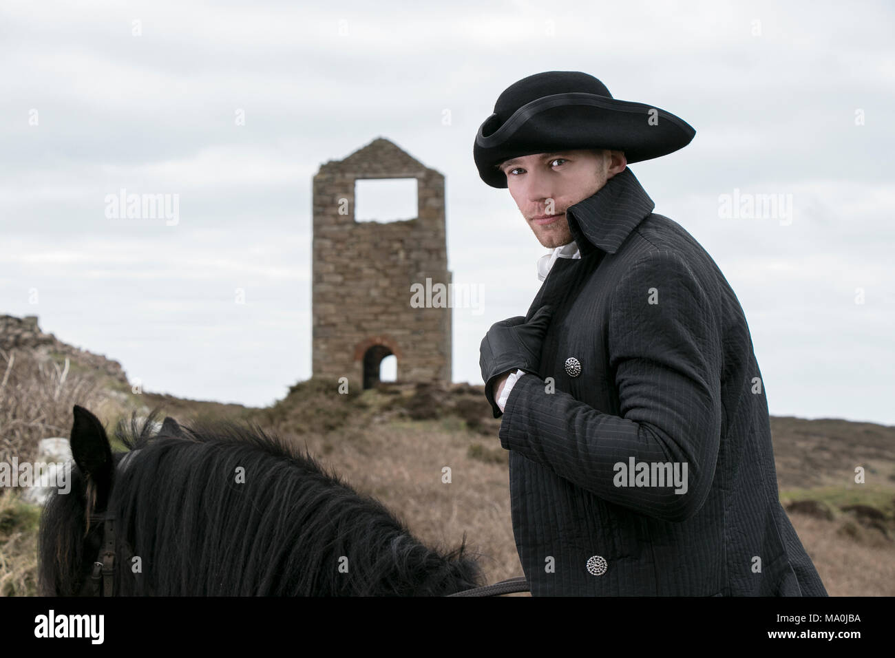 c5178812e9c Handsome Male Horse Rider Regency 18th Century Poldark Costume with tin  mine in background - Stock
