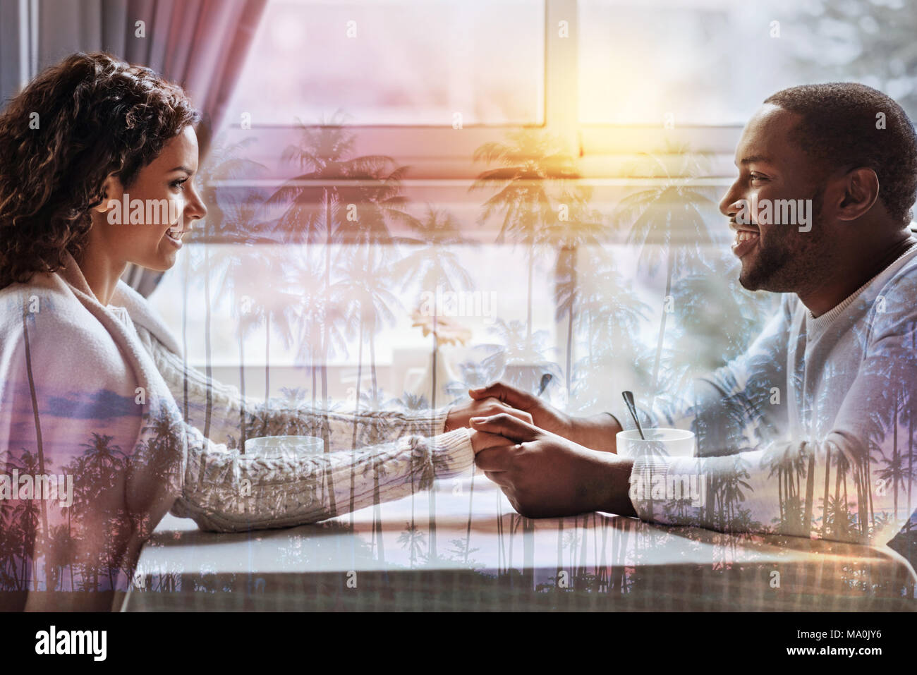 Profile of pleasant couple sitting in front of each other - Stock Image