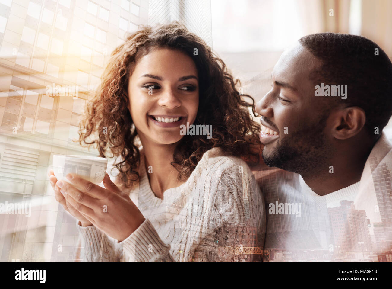 Positive couple enjoying being together - Stock Image