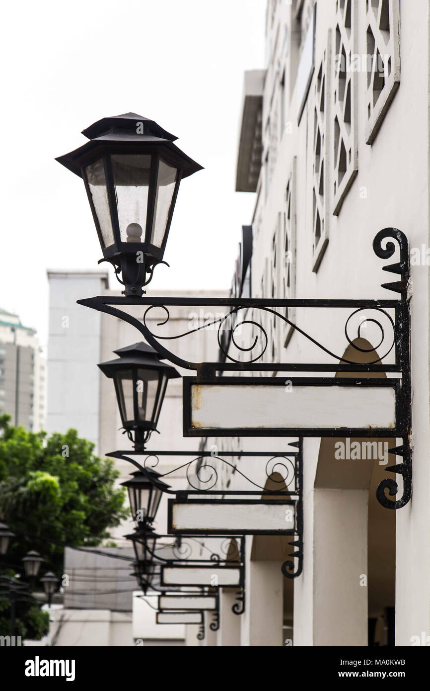 Old lamp and street sign Stock Photo