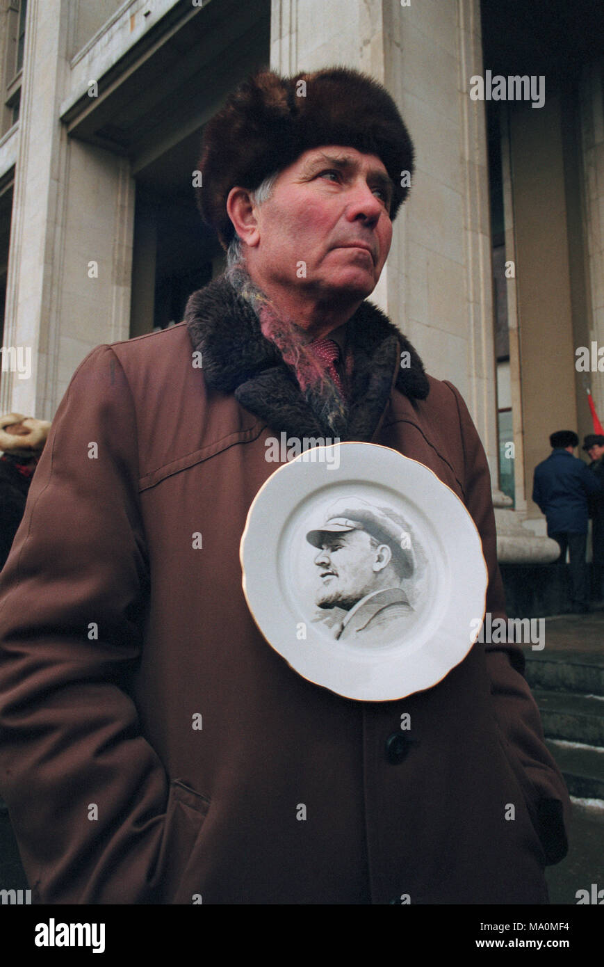 Moscow, Russia - February 09, 1992: Pro communist rally on Manezh square. Senior man holding plate with portrait of Lenin. - Stock Image