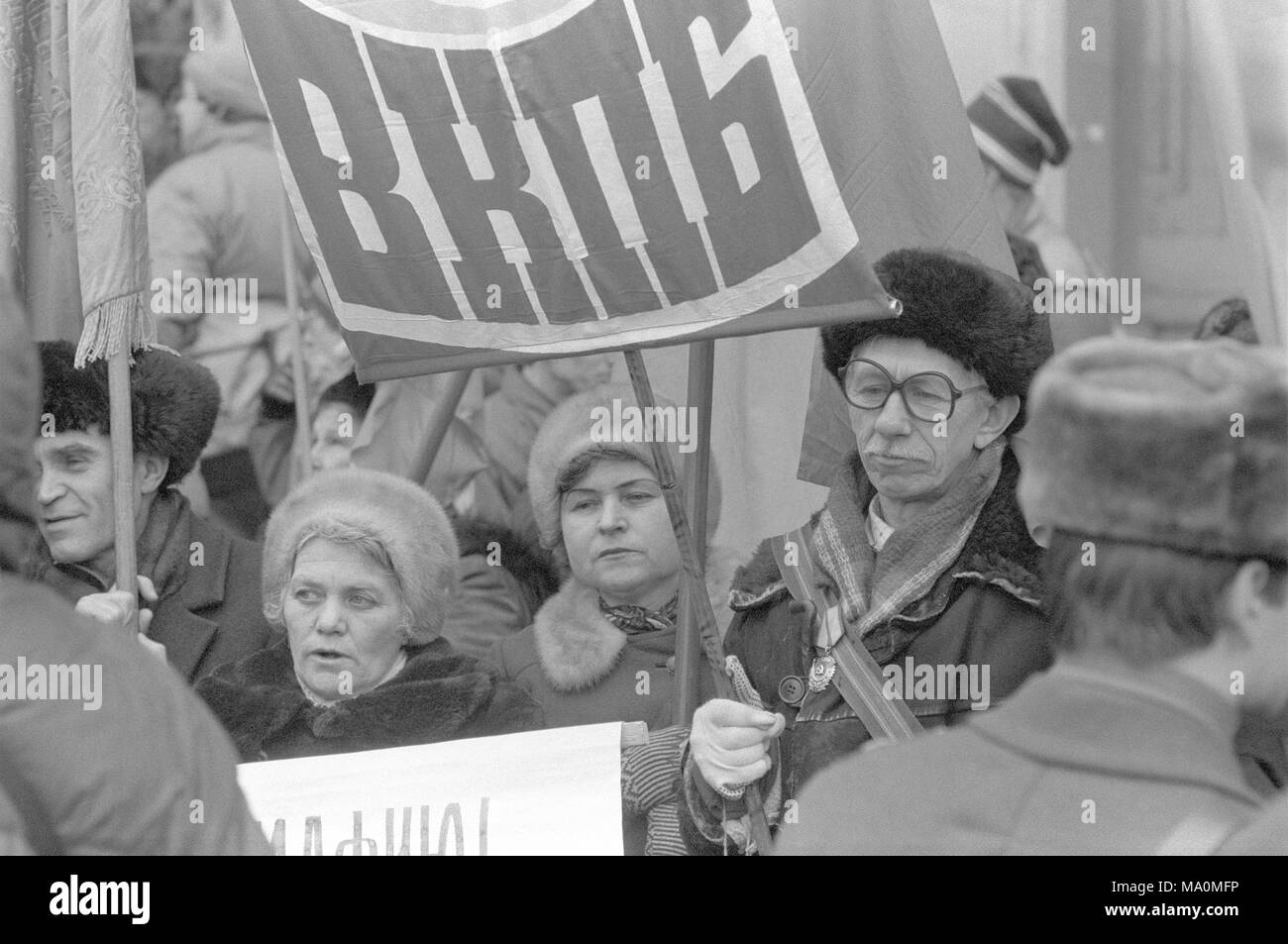 Moscow, Russia - February 09, 1992: Pro communist rally on Manezh square. The slogan has russian abbreviation for All Union Communist Party of Bolsheviks. - Stock Image