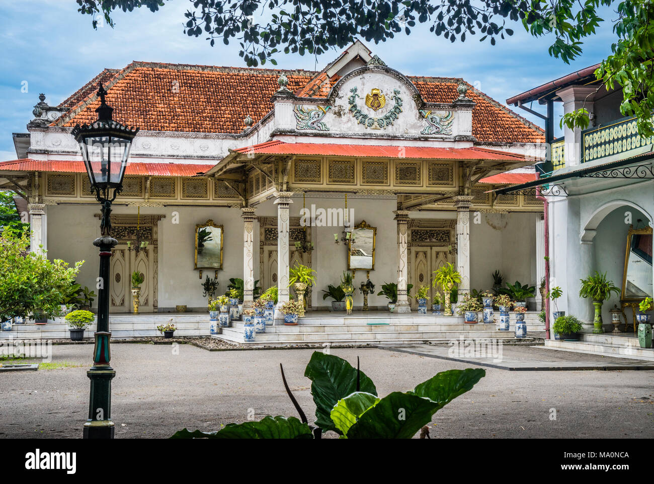 prominent palatial building of javanese architecture, influenced by Dutch Colonial style, Gedong Jene, also known as the yellow building at the Kraton - Stock Image