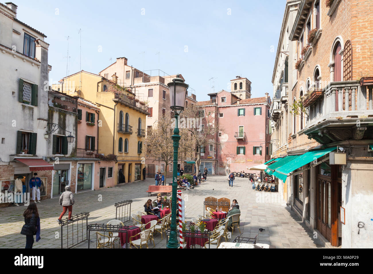 Campo Santa Maria Formosa, Cannaregio, Venice, Veneto, Italy with tourists dining at an open air restaurant in an elevated view in winter - Stock Image