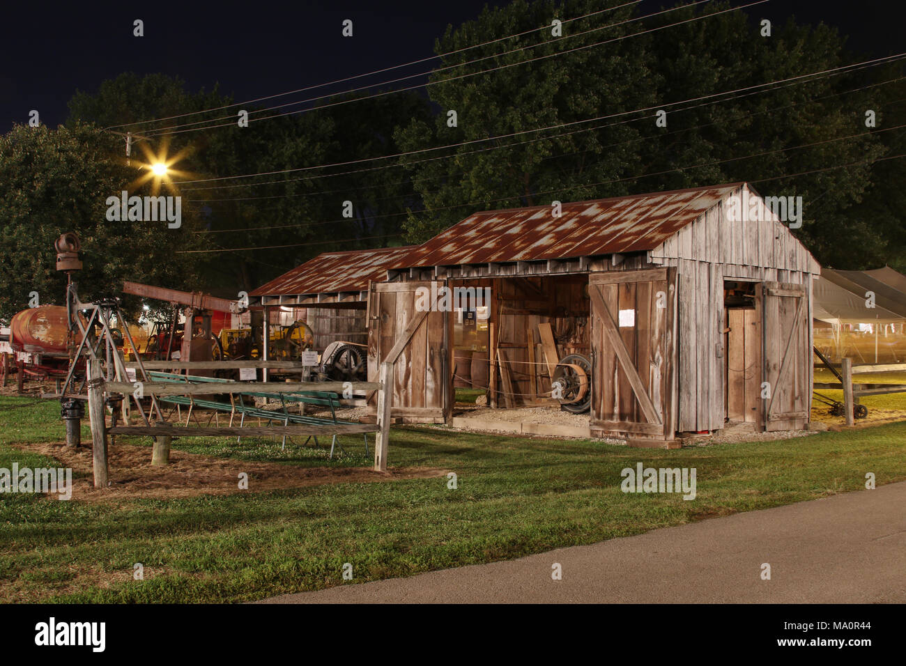Antique Oilfield Exhibit at night. Canfield Fair. Mahoning County Fair. Canfield, Youngstown, Ohio, USA. - Stock Image