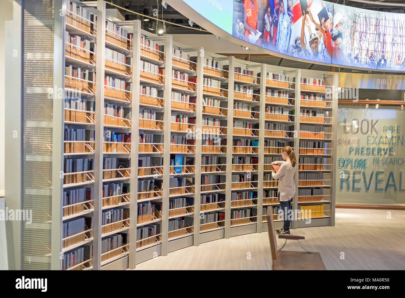 Washington, DC - The Museum of the Bible includes a room displaying Bibles that have been translated into hundreds of languages.Stock Photo