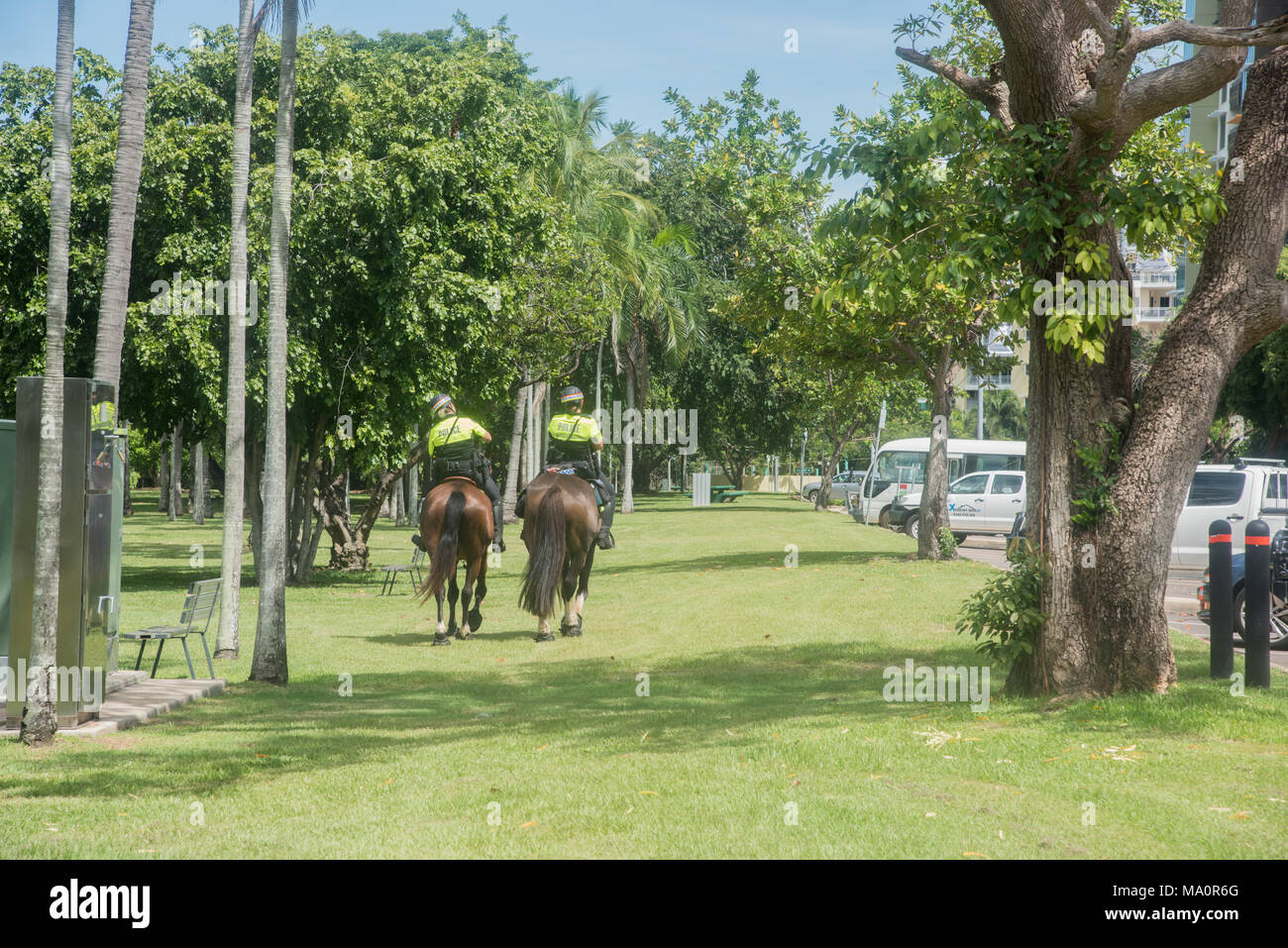Darwin,Northern Territory,Australia-February 21,2018: Police force on horseback at Bicentennial Park with greenery in Darwin, Australia - Stock Image