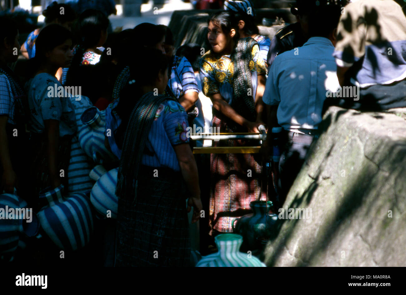Tz'utujil Maya queue for their ration of drinking water in San Lucas Tolimán, Guatemala after the devastation of Hurricane Stan in October, 2005. - Stock Image