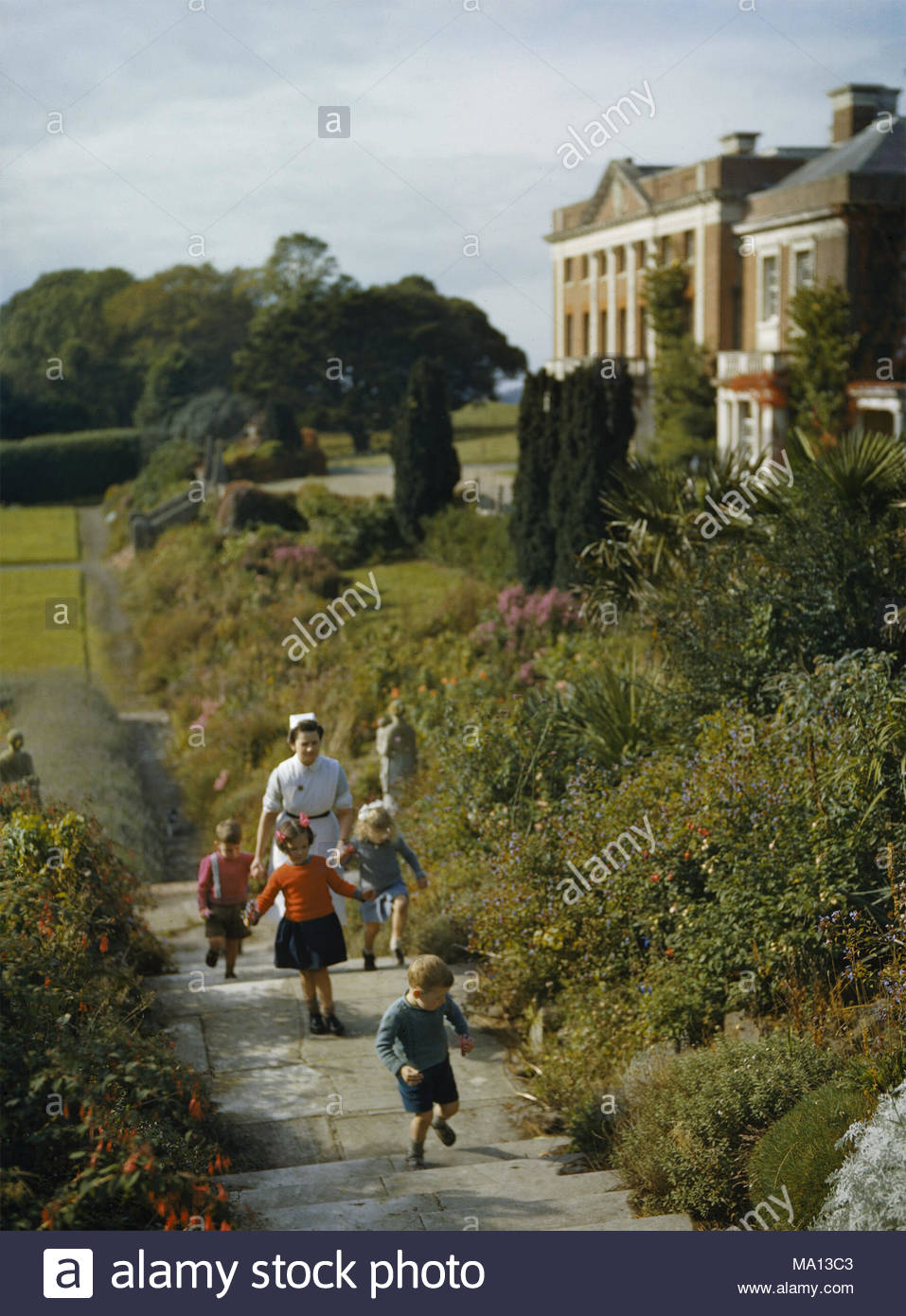 The Home Front in Britain 1939-1945 A nurse with child evacuees from ...