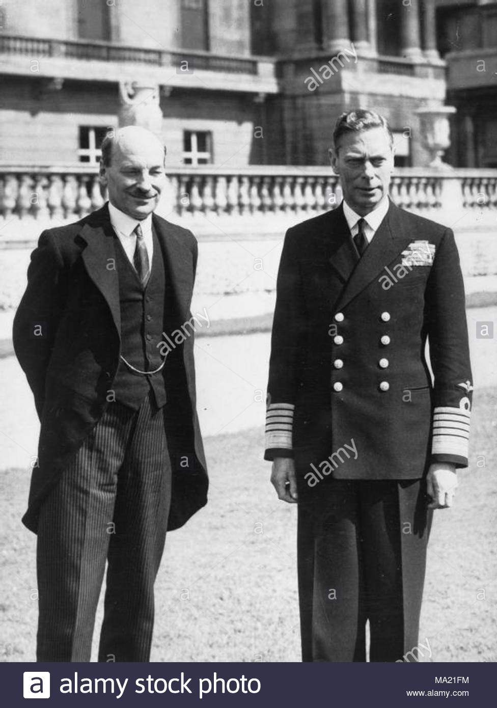 . Clement Attlee meeting with King George VI in the grounds of Buckingham Palace, following the Labour victory in the 1945 general election. - Stock Image
