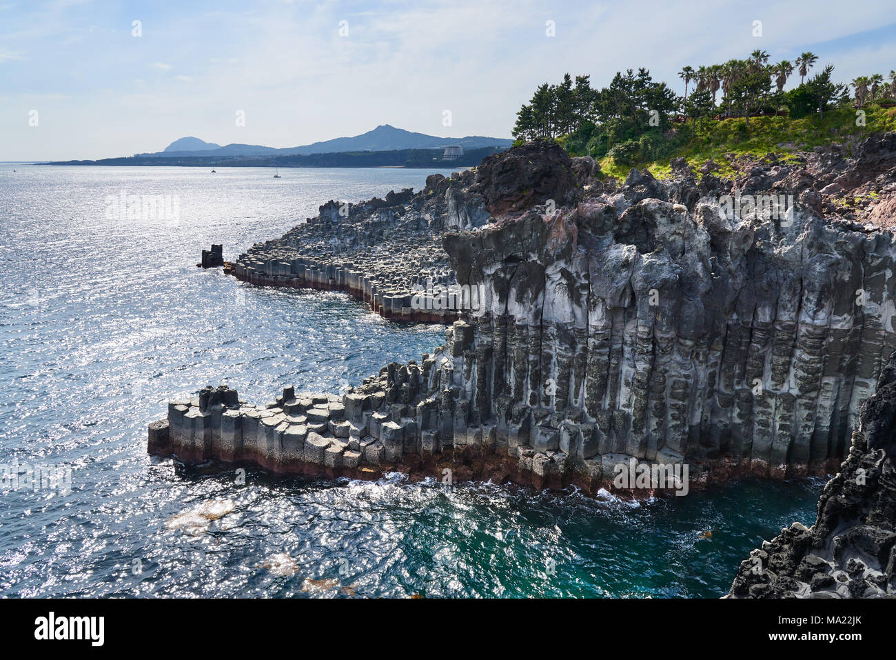Daepo Jusangjeolli at Jungmun in Jeju, Korea. Jusangjeolli is a cliff made of basaltic columnar jointings at Jisatgae coast and one of the most famous - Stock Image