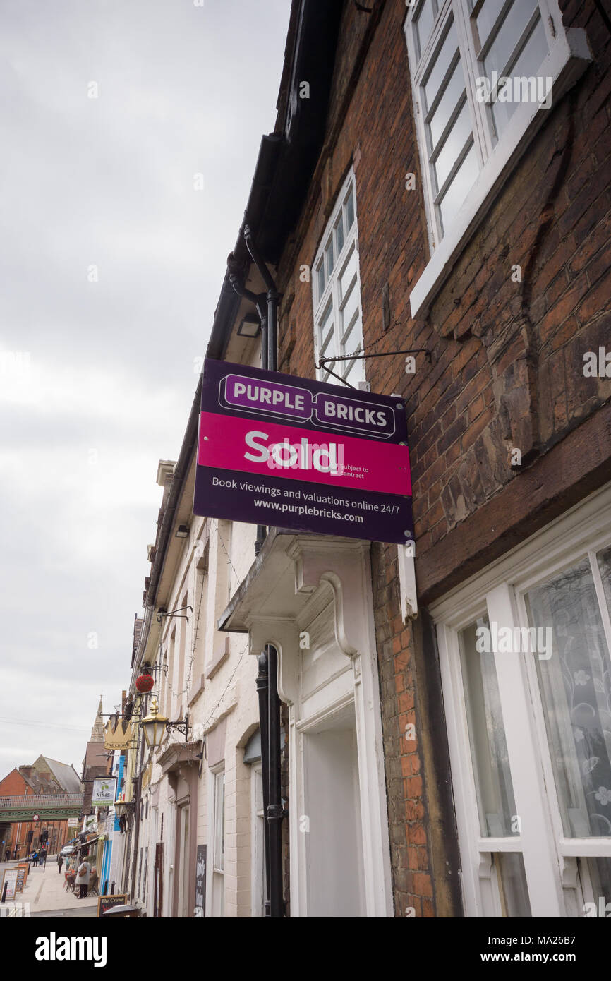 Purple Bricks Group PLC estate agents sold sign on a terraced house Stock Photo