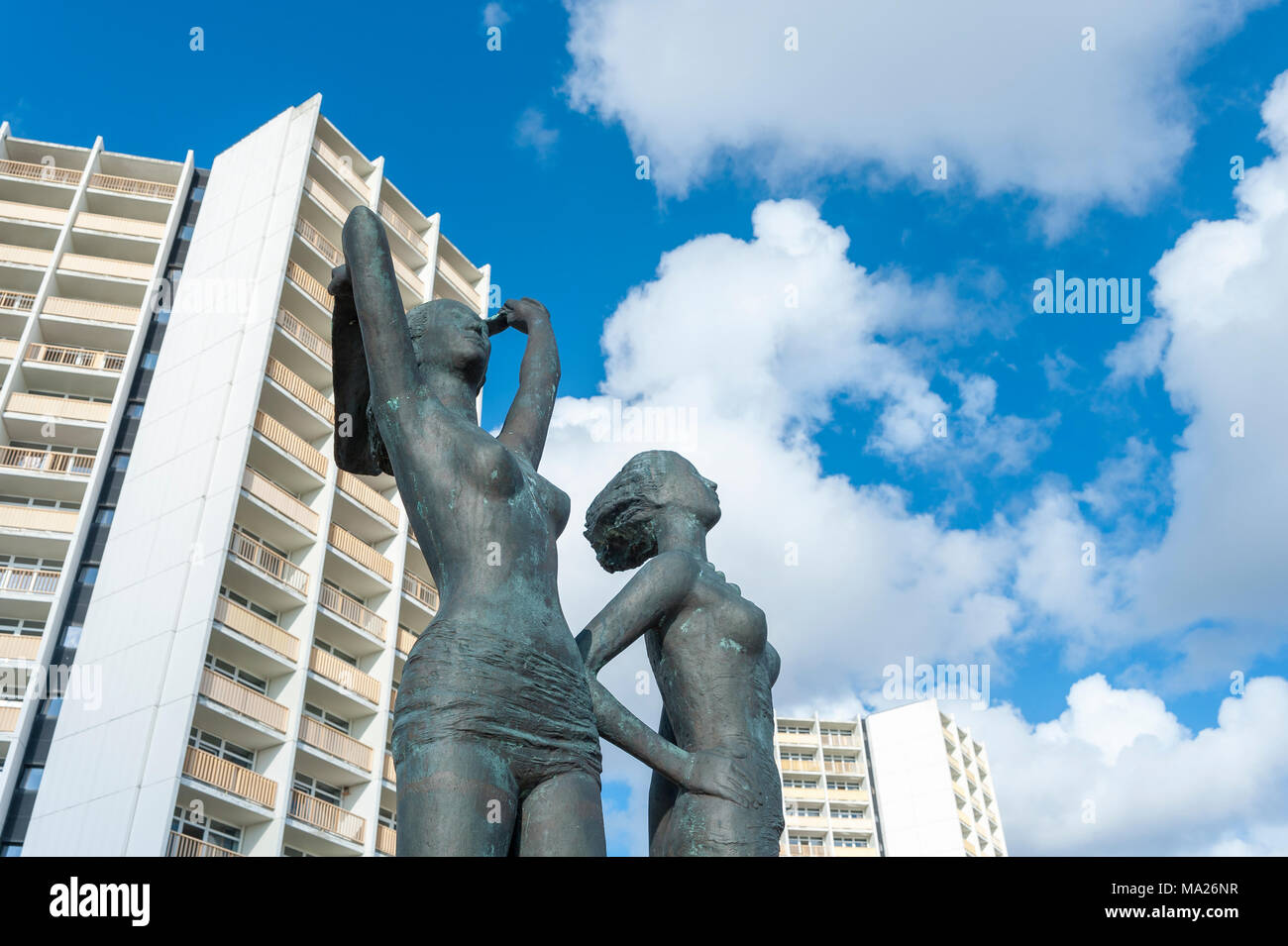 Bronze sculpture, Girl on the south beach, in front of the facade of the Hotel and holiday center IFA, Burgtiefe, Fehmarn, Baltic Sea, Schleswig-Holst - Stock Image