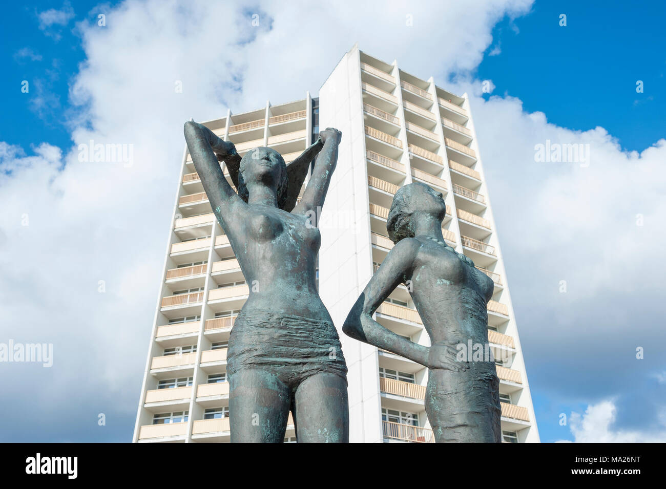 Bronze sculpture, Girl on the south beach, in front of the facade of the Hotel and holiday center IFA, Burgtiefe, Fehmarn, Baltic Sea, Schleswig-Holst Stock Photo