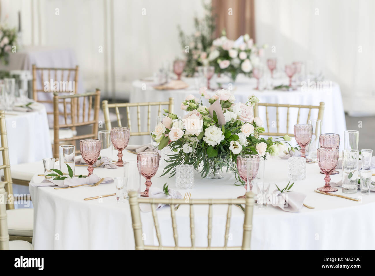 Beautiful table setting with crockery and flowers for a party ...