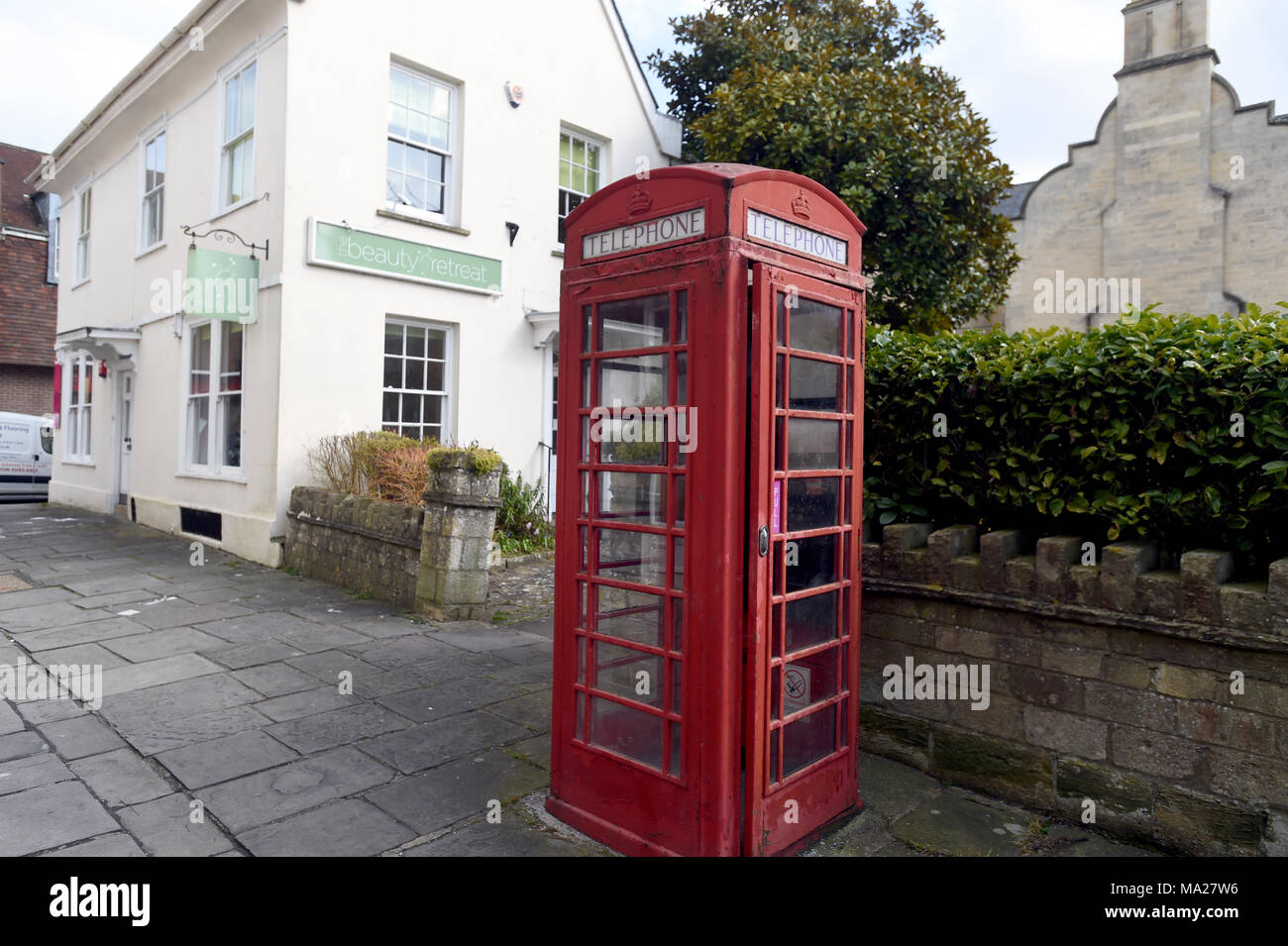Red telephone box in the town of Devizes in the county of Wiltshire UK - Stock Image