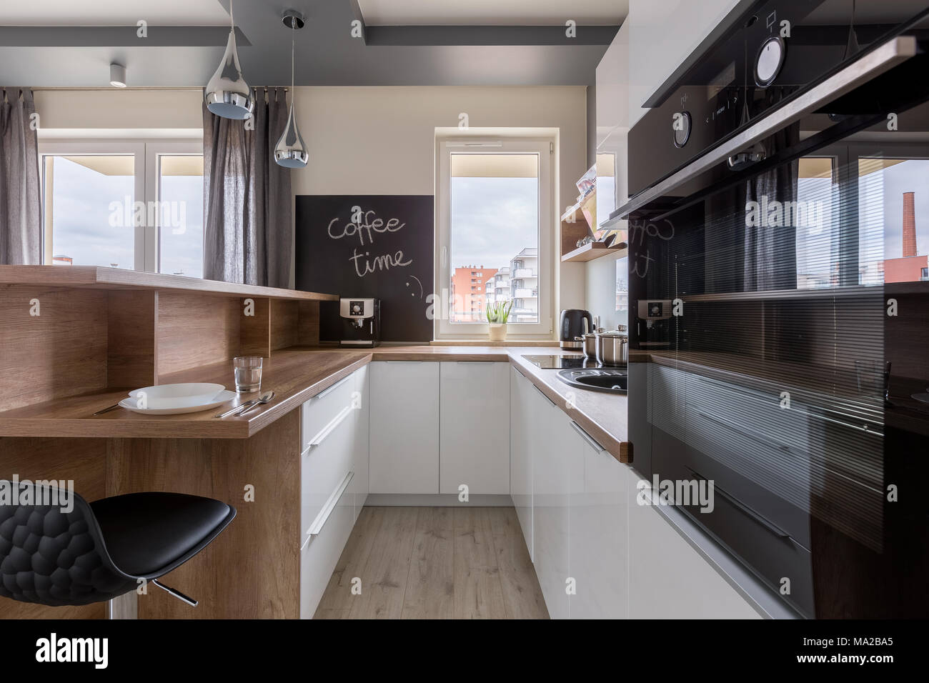 Contemporary Kitchen With Wooden And White Kitchen Cabinets