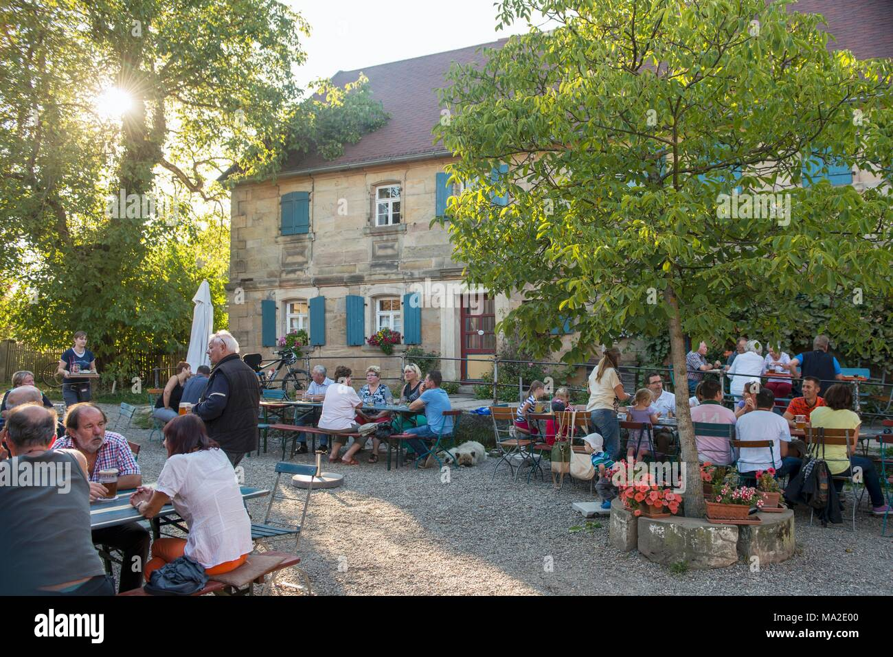 The beer garden of the guesthouse 'Auf der Theta' in Bindlach, Bayreuth, Fichtel Mountains, Upper Franconia - Stock Image