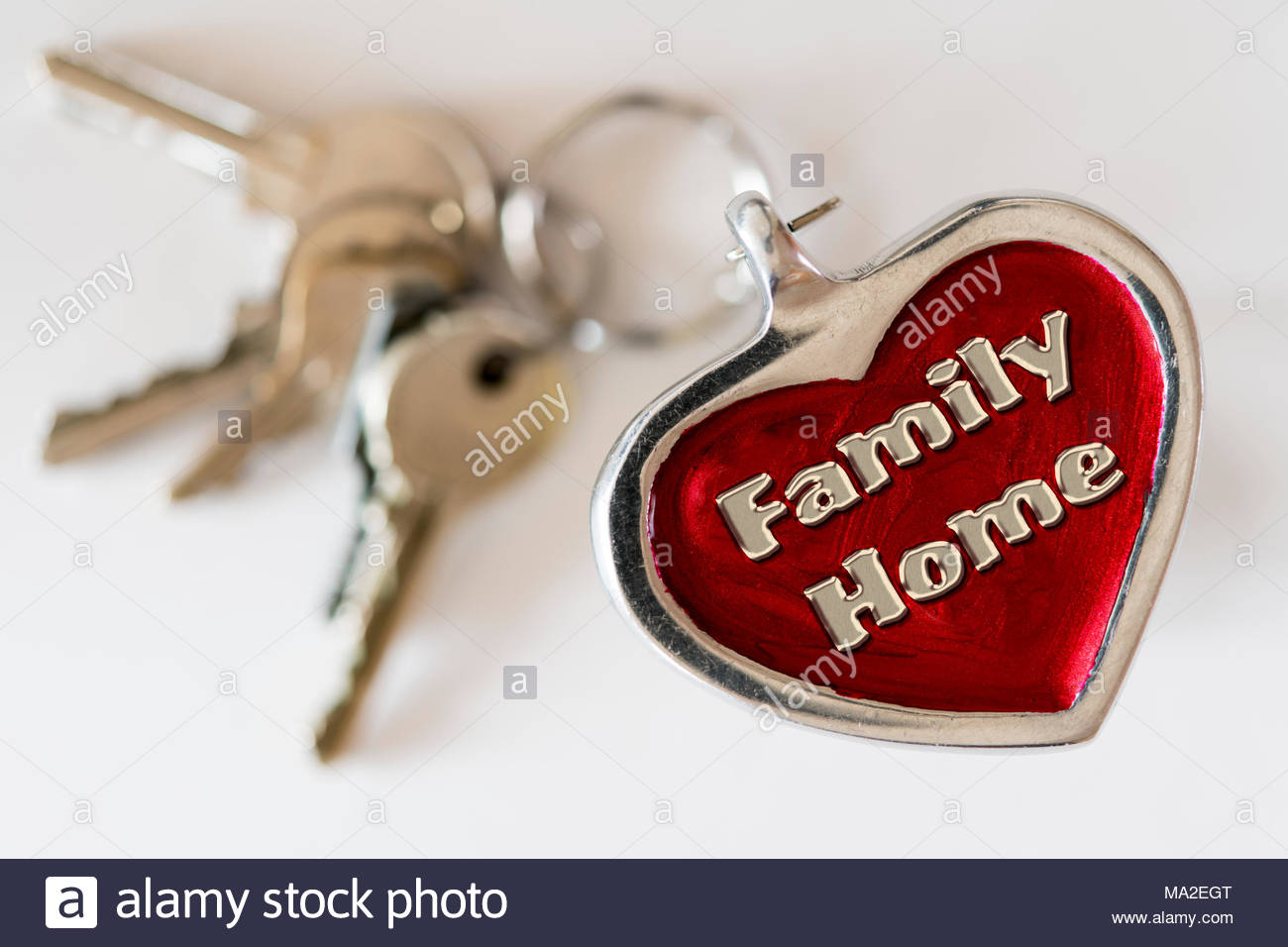 Family home written on a key ring fob, UK - Stock Image