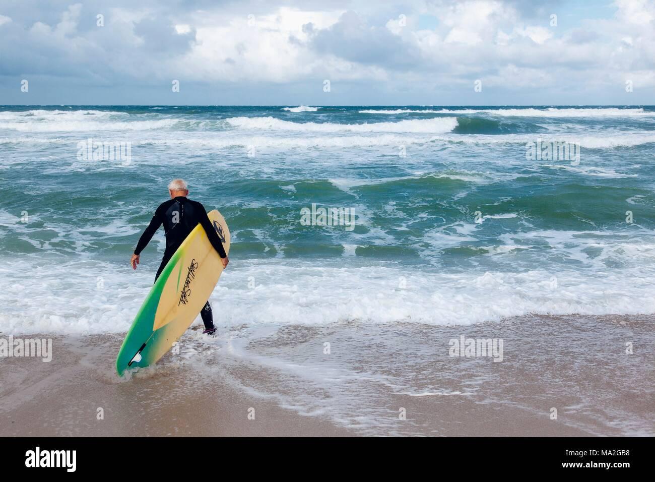 Surfing legend Uwe Behrens still rides the waves, Sylt - Stock Image