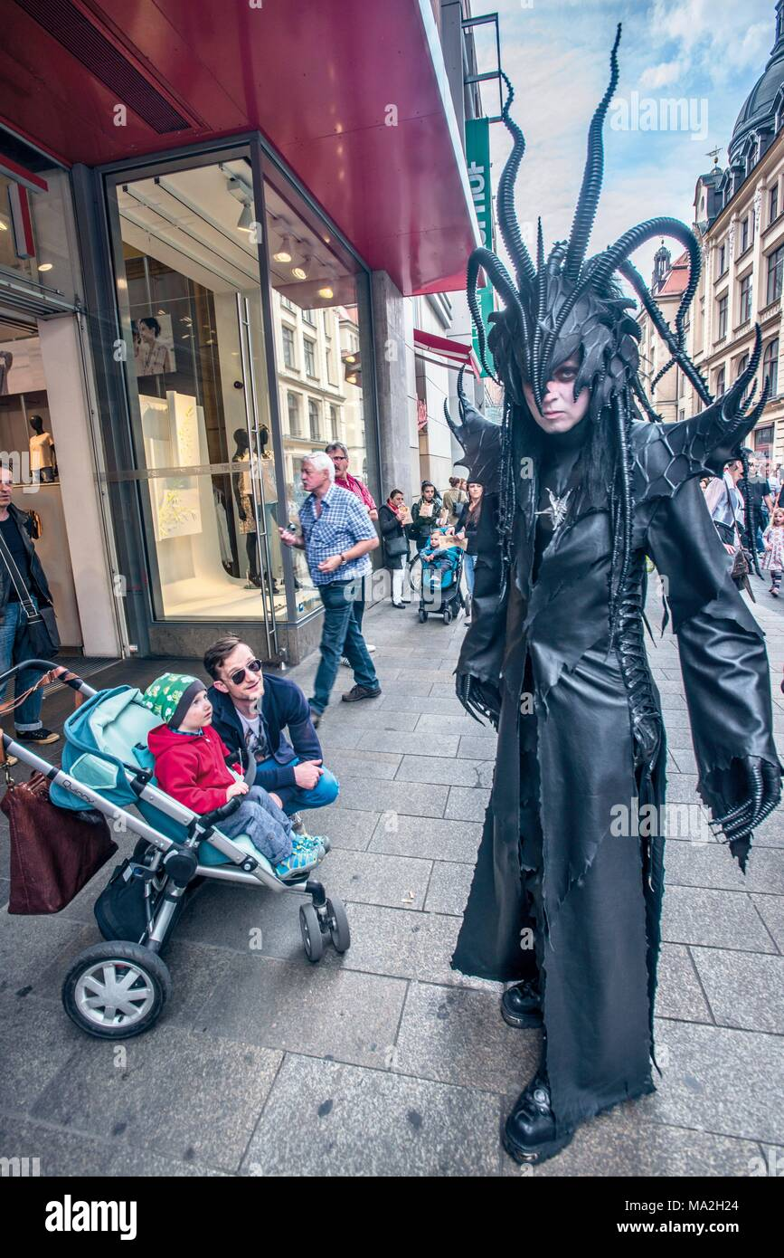Wave-Gotik-Festival: a man wearing an elaborate black costume in Leipzig - Stock Image