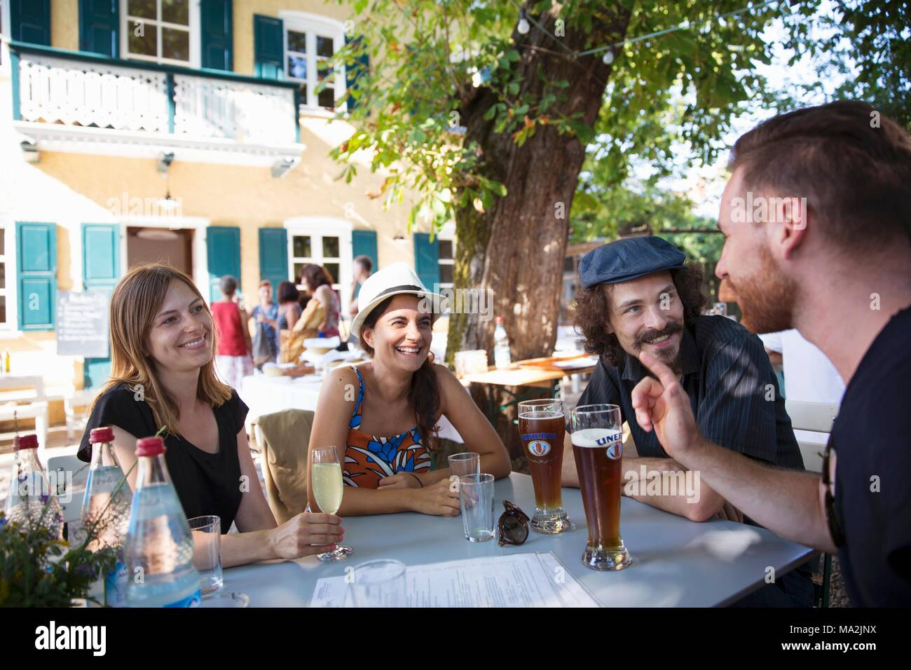 Guests in the Fischmeister's beer garden, Münsing, Upper Bavaria - Stock Image