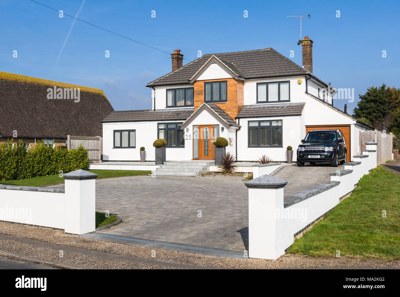 Large modern new detached house in a town in West Sussex, England, UK. Stock Photo