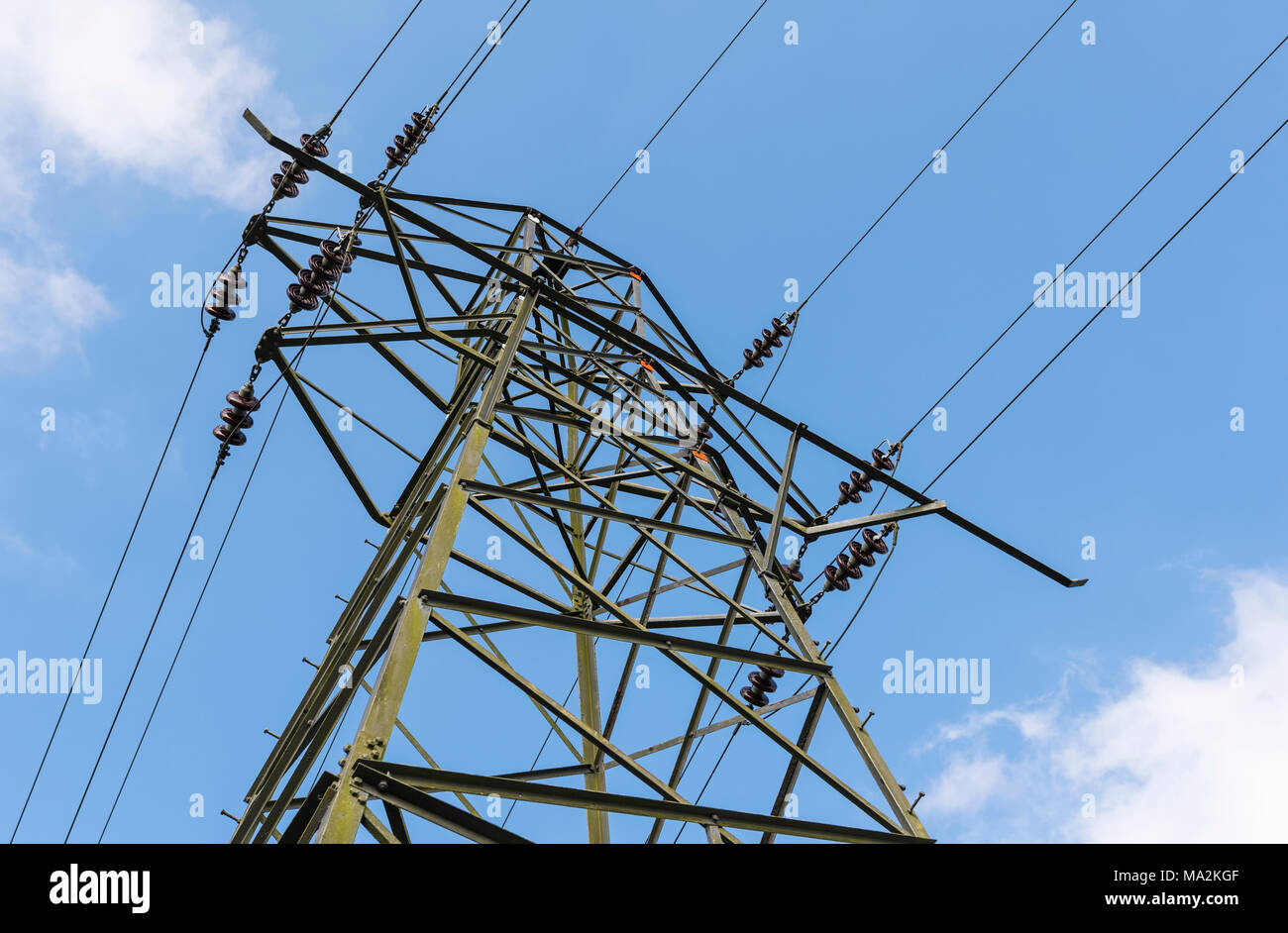 Electricity pylon and wires carrying electrical power on the National Grid in the UK. - Stock Image