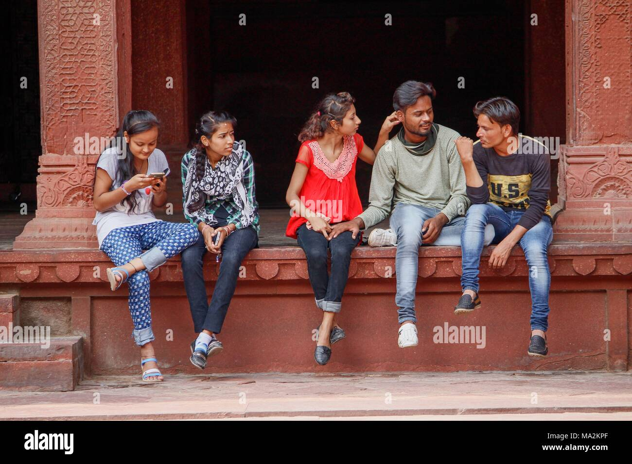 A group of young Indian people having nice time - Stock Image