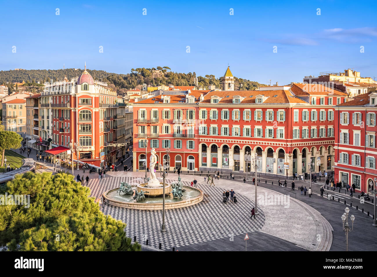 Aerial view of Place Massena square with red buildings  and fountain in Nice, France - Stock Image