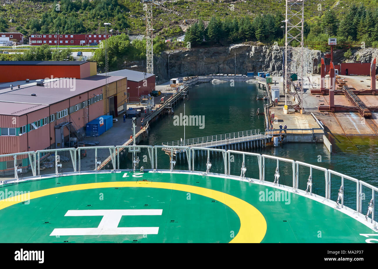 The Oceanic Endeavour slowly reversing out of the water filled Dry Dock at the Baatbygg Shipyard in Maloy, Norway, after having work done. - Stock Image