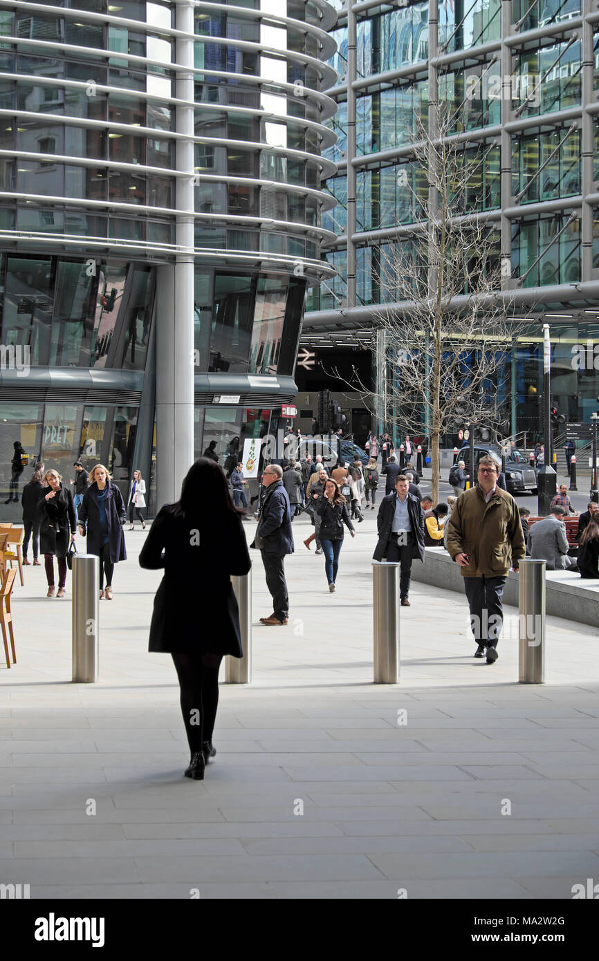People walking towards Cannon Street Station outside Bloomberg European Headquarters arcade and new building in the City of London UK   KATHY DEWITT - Stock Image